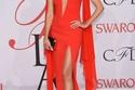Natasha Poly Wearing modern cutouts gown