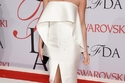 Chrissy teigwn wearing simple white modern cutouts Solace London gown