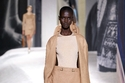 معطف وتنورة جلد من Hermès