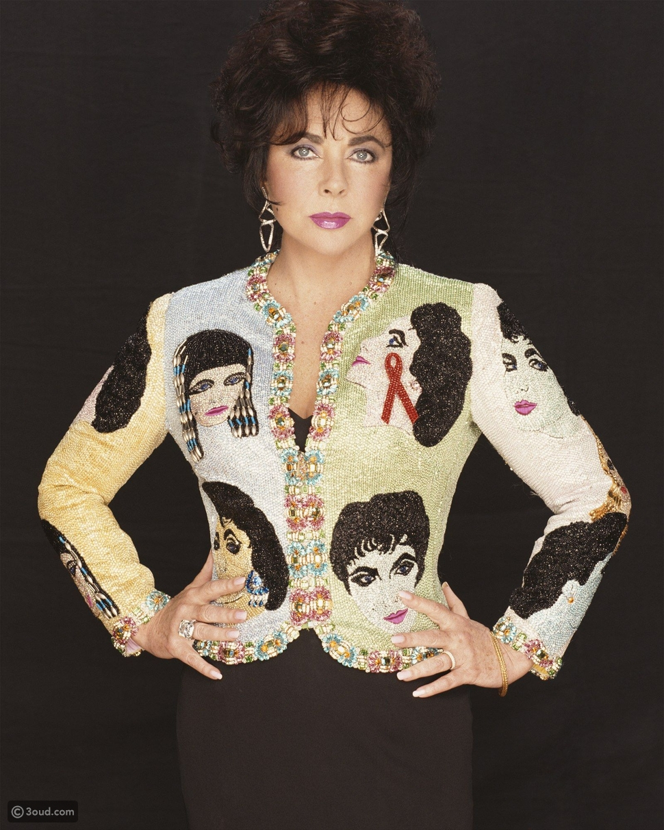 """Versace beaded """"The Face"""" evening jacket owned by Elizabeth Taylor, embroidered with rhinestone portraits of the star in her most iconic roles, sold at Christie's in 2011: $128,500"""